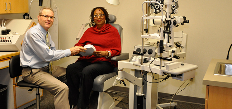 an image of Dr. Stephen with a patient in the evaluation room