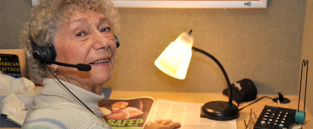 Photo of a woman using the telephone reader service