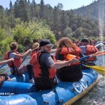 An excited group rafting down the river!