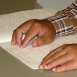 image of person reading braille