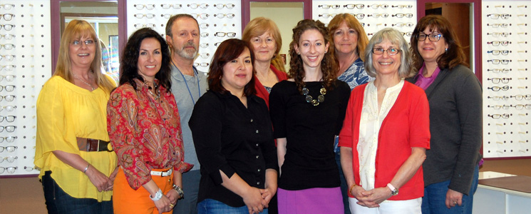An image of the Society for the Blind team posting for a photograph