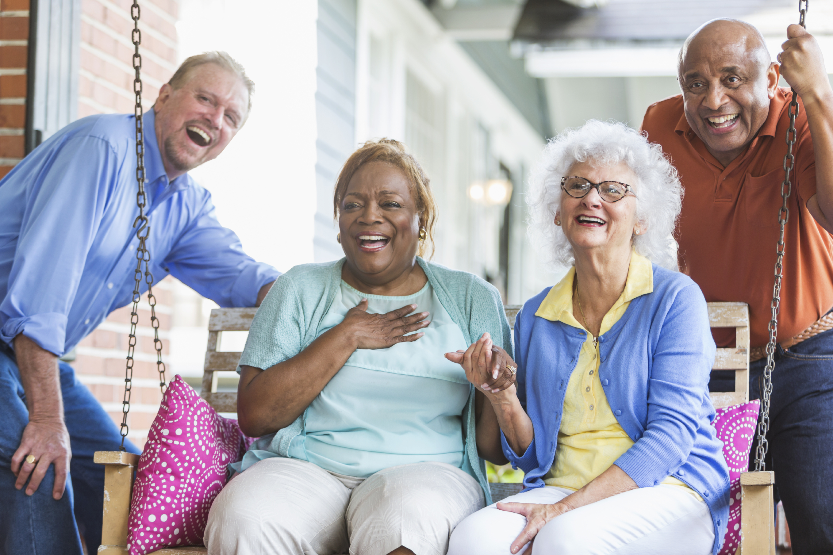 Group Of Multiracial Seniors On Porch Swing Society For