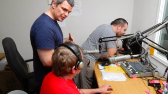 Society for the Blind and Reading Service of the Redwoods staff work together in the Arcata recording booth.