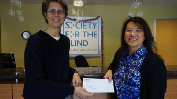 Tisha Mora, US Bank, presenting check to Shari Roeseler