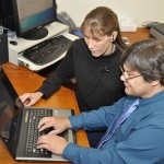 student and mentor working with assistive tech