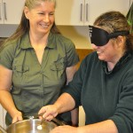 woman learning how to make cookies at society for the blind