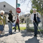 Senior Impact Program participants walking with canes Society for the Blind