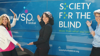 Kate Renwick-Espinosa, Toni Boom, and Shari Roeseler show off the new mobile low vision clinic!