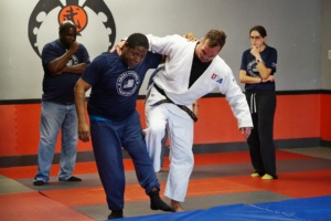 NFC participant practicing Judo techniques with instructor, Greg DeWall