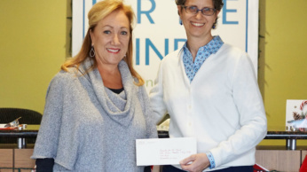 Photo of Margaret Whitmire presenting grant check to Shari Roeseler