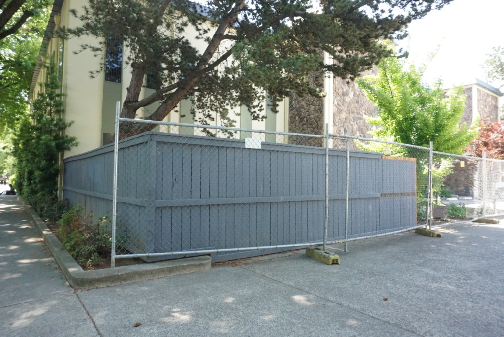 New wire fencing around the back lot of Society for the Blind during the construction project