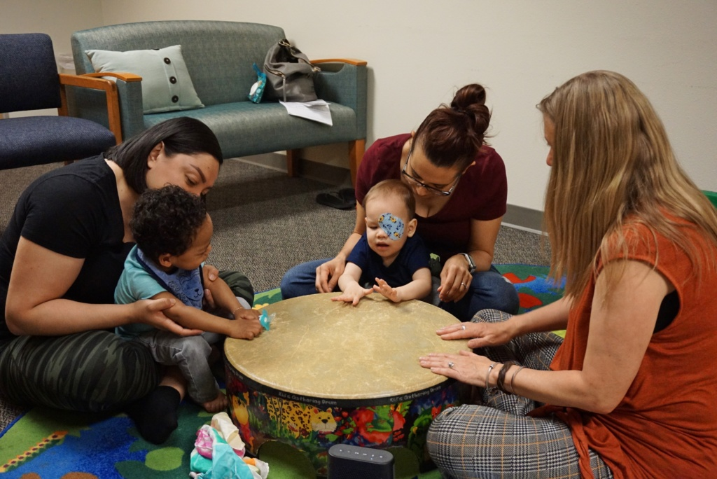 Toddler-Parent Group Engaging in a Drum Circle