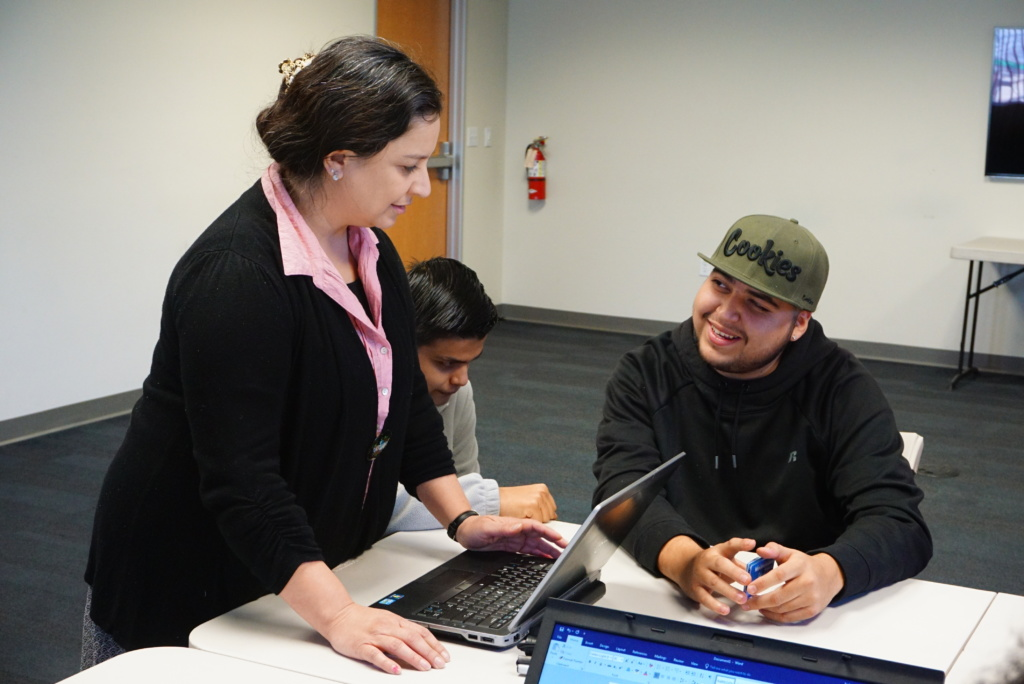 CareersPLUS Program Assistant Isabel with Two Students Learning Assistive Technology