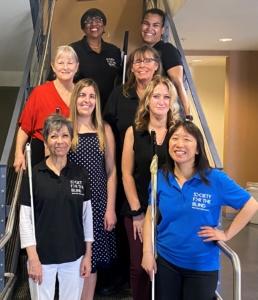 Staff of Society for the Blind from Left to Right in Descending order: Debra Pendelton, Liz Campos, Kathleen Shevlin, Sheriann Garrett, Heather Perry, Laura Monaco, Debra Celiz, and Priscilla Yueng