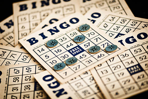 Stack of Bingo cards with markers on top