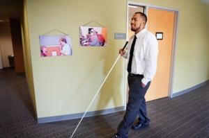 Alex Zuniga, SIP Instructor, walks through a hallway at Society for the Blind